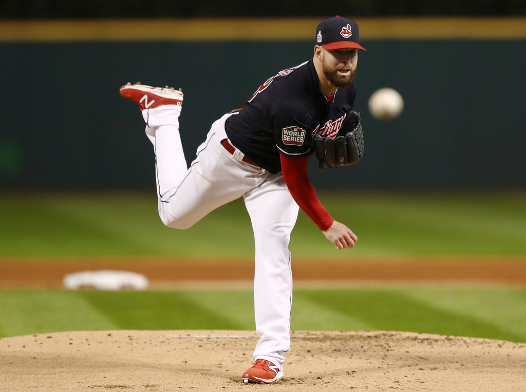 . Cleveland Indians starting pitcher Corey Kluber throws during the first inning of Game 1 of the Major League Baseball World Series against the Chicago Cubs Tuesday, Oct. 25, 2016, in Cleveland. (AP Photo/Elsa Garrison)