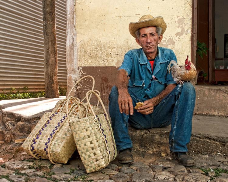 Cuba Trinidad man w chicken 8138.jpg