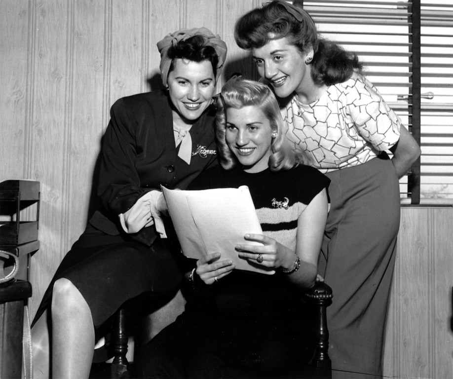 . The Andrews Sisters, radio and stage entertainers, go over a song together on May 7,1945. From left to right are: Maxene, Patti and LaVerne. (AP Photo)
