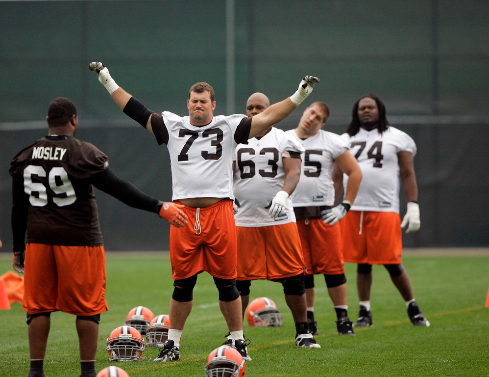 . Cleveland Browns\' Joe Thomas (73), Kurt Quarterman (63), Alex Mack (55) and George Foster (74) stretch  during practice at minicamp at the Browns training facility Thursday, June 11, 2009, in Berea, Ohio. (AP Photo/Tony Dejak)