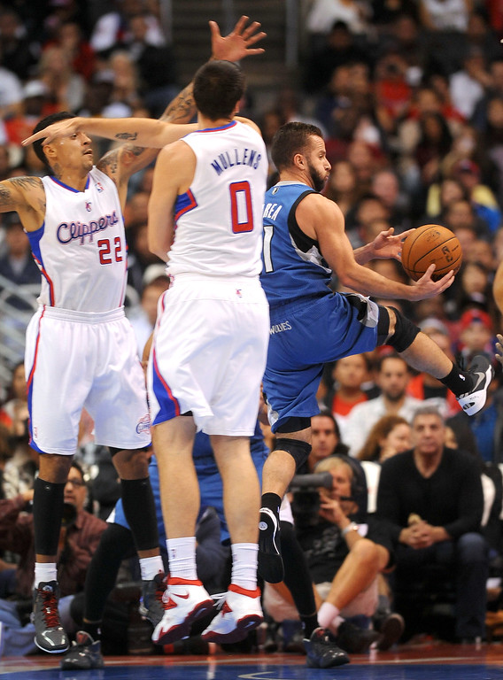 . Timberwoves\' Jose Barea gets up Los Angeles Clippers defenders Matt Barnes and Byron Mullens Monday, Nov. 11, 2013, in Los Angeles.  The Clippers won the game 109-107.(Andy Holzman/Los Angeles Daily News)