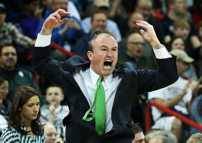 . Head coach Saul Phillips of the North Dakota State Bison reacts in the second half against the San Diego State Aztecs during the Third Round of the 2014 NCAA Basketball Tournament at Spokane Veterans Memorial Arena on March 22, 2014 in Spokane, Washington.  (Photo by Stephen Dunn/Getty Images)