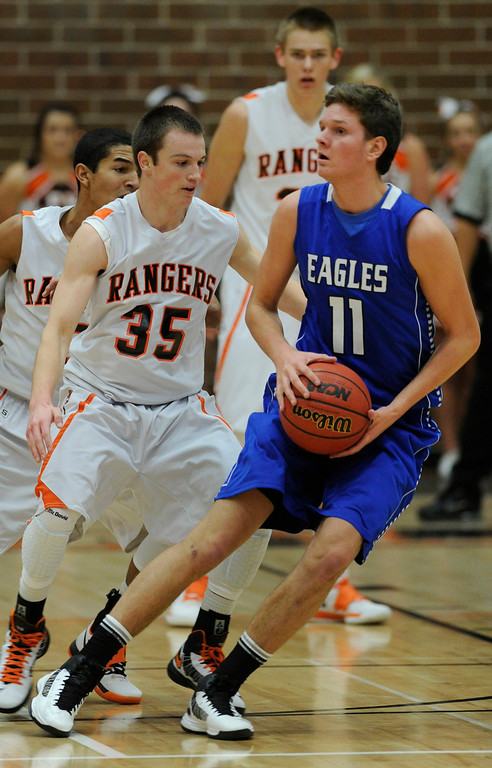 . Broomfield guard Spenser Reeb (11) looked to pass in the first half. The Lewis-Palmer High School boy\'s basketball team defeated Broomfield 75-53 Friday night, December 7, 2012.  Karl Gehring/The Denver Post