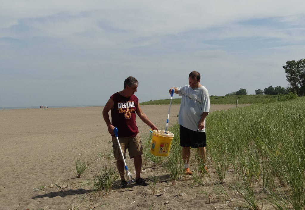 . Submitted <br> Bruce Hilborn and John Stief take part in a beach clean project at Mentor Headlands Beach.