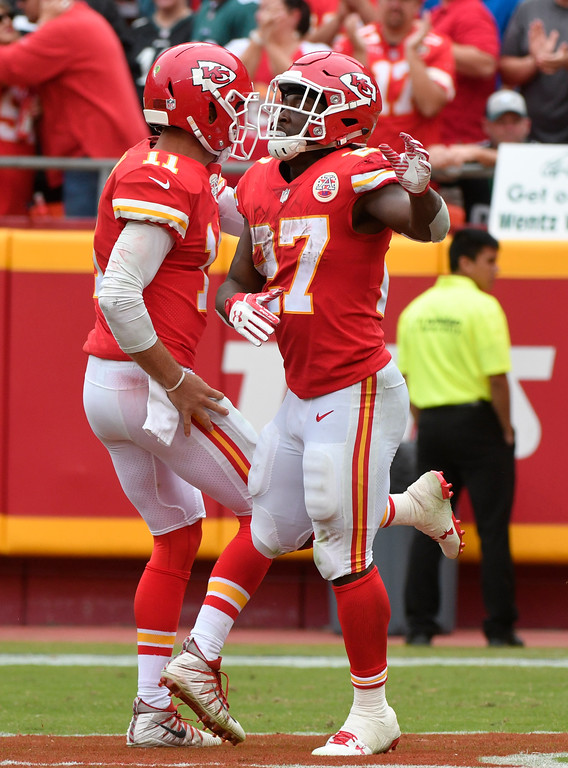 . Kansas City Chiefs running back Kareem Hunt (27) celebrates with quarterback Alex Smith (11) after scoring a touchdown during the second half of an NFL football game against the Philadelphia Eagles in Kansas City, Mo., Sunday, Sept. 17, 2017. (AP Photo/Ed Zurga)