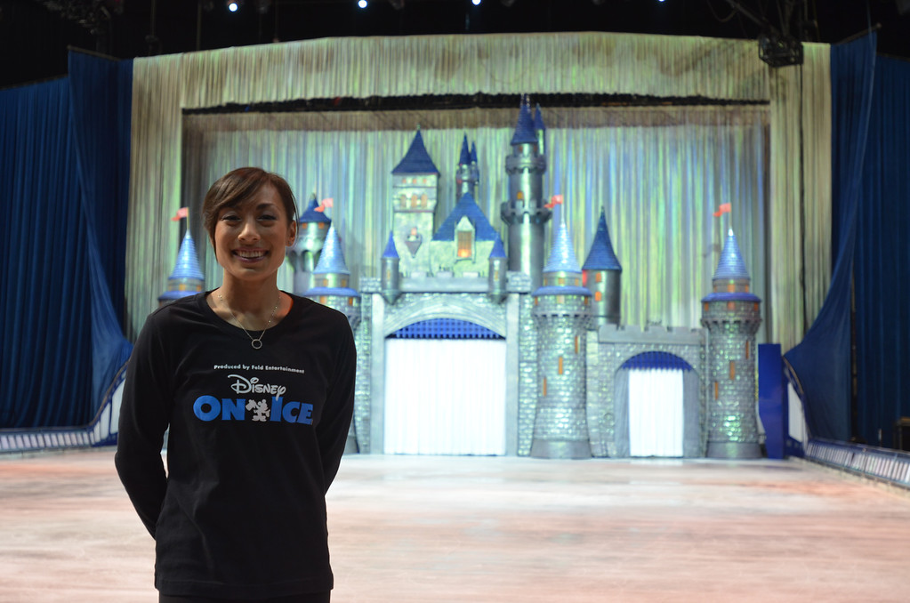 . Danielle Leong, a skater with Disney On Ice and former Detroit Skating Club member, stands in the ice ring while her fellow skaters practice before the start of the show at The Palace of Auburn Hills to celebrate 100 Years of Magic.