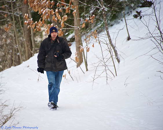 Andy walks on the trail to the Great Fall in the Woods.