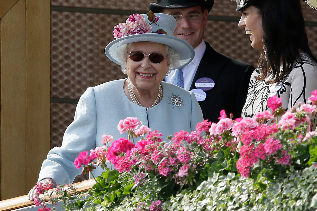 . Britain\'s Queen Elizabeth II watches horses in the parade ring before the fifth race on the second day of the Royal Ascot horse race meeting in Ascot, England, Wednesday, June 20, 2018. (AP Photo/Tim Ireland)