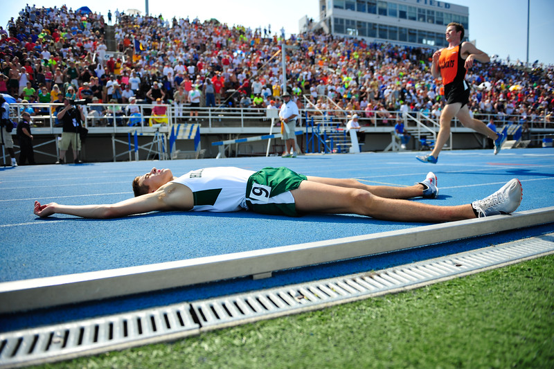 Glenbard West's Mike Lederhouse lays in exhaustion after fiinishing the Class 3A 1600-Meter Run at the Track & Field State Finals, Saturday, May 26th, 2012 in Charleston, IL. | Gary Middendorf~For Sun-Times Media