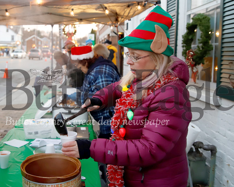 Peg Nestor and members of the Zelienople Historical Society serve up grill cheese and tomato soup at Zelienople's Miracle on Main Street Thursday. Seb Foltz/Butler Eagle