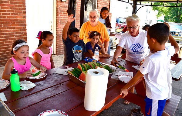 8/15/20019 Mike Orazzi | Staff Bristol Garden Club Members Claudette Dekoe and Jennie Guffany passes out fresh fruit to children in Cambridge Park as part of their summer gardening program in conjunction with the Bristol Boys & Girls Club on Thursday.