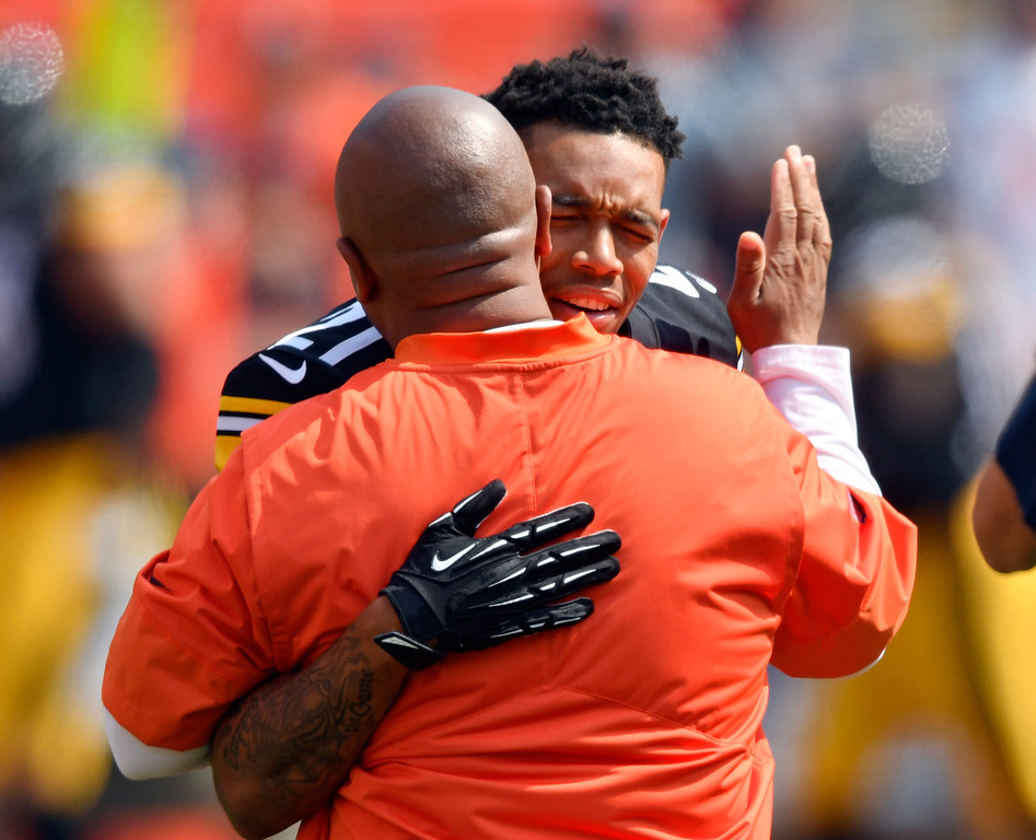 . Pittsburgh Steelers cornerback Joe Haden, right, hugs Cleveland Browns head coach Hue Jackson before an NFL football game, Sunday, Sept. 10, 2017, in Cleveland. (AP Photo/David Richard)