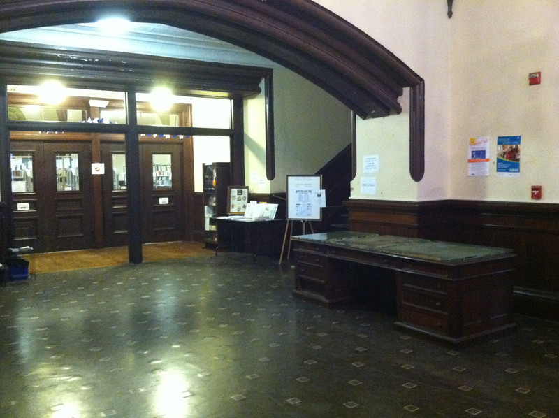 Library lobby in City Hall, 2nd floor.  Note the large desk on right, temporarily topped the 3 glass panels.  January 2013.