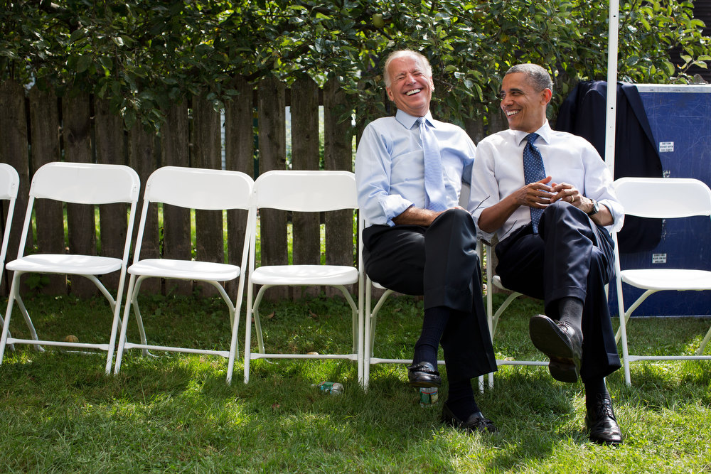". Sept. 7, 2012 ""The President and Vice President share a laugh before a campaign rally together in Portsmouth, N.H.\""  (Official White House Photo by Pete Souza)"