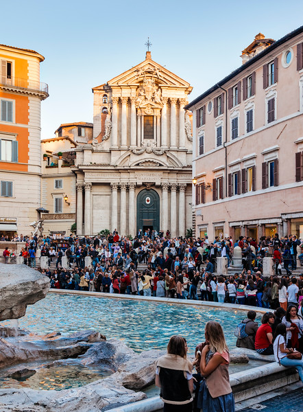 Saints Vincent and Anastasius Church next to Trevi Fountain with tourists in Rome, Italy