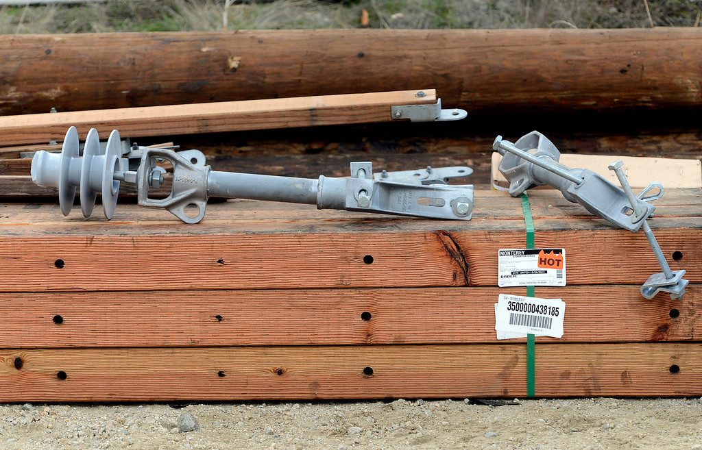 . New electrical poles and gear to replace those damaged by the fire sit in the turnout at the junction of Pfeiffer Ridge Road and Highway 1 in Big Sur, Calif. on Thursday December 19, 2013. (Photo David Royal/ Monterey County Herald)