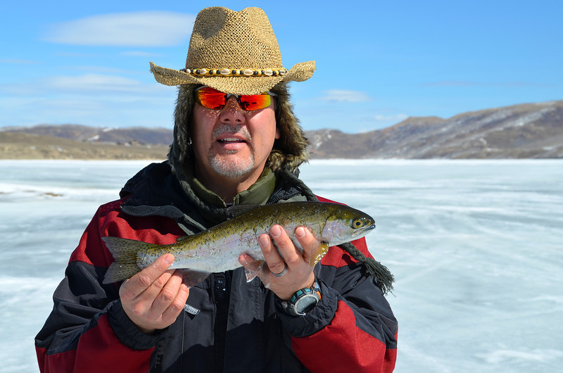 2012-3-14 ––– I took my dad ice fishing for the last time of the season. It is getting too warm and the ice is melting. We still had about 16 inches of ice, but it was watery on top. We didn't catch many fish, but we did catch a couple really nice rainbow trout. This was my best one. My cheeks got a little sunburned from sitting on the ice all day, but we had a great time.