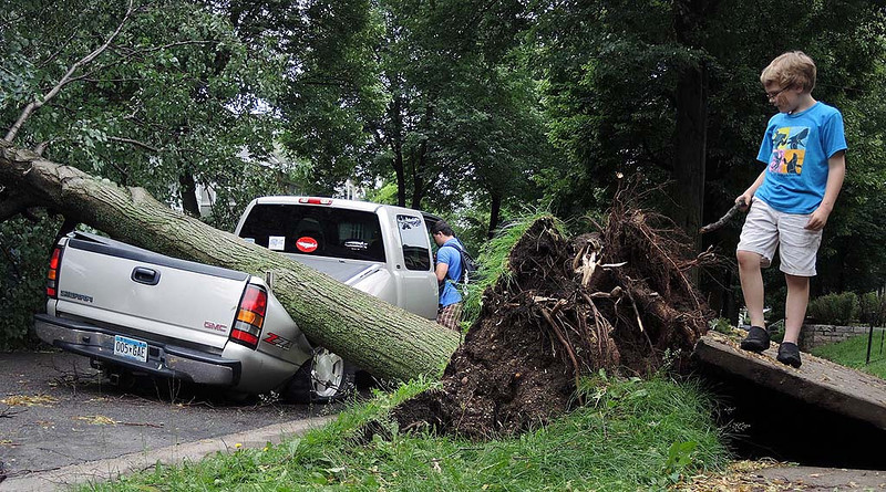 """. A large boulevard tree in the 3100 block of James Avenue South in Minneapolis fell onto Eagan resident Josh Nelson\'s 2007 GMC Sierra pickup truck during Friday evening\'s storm. Nelson, at passenger door, visited his truck to get some personal items Saturday afternoon. \""""When I saw it last night for the first time, I kind of laughed. People were taking pictures and asked me if this was my truck.\"""" There were no injuries. \""""I am thankful for that,\"""" he said. (Pioneer Press: Chris Polydoroff)"""