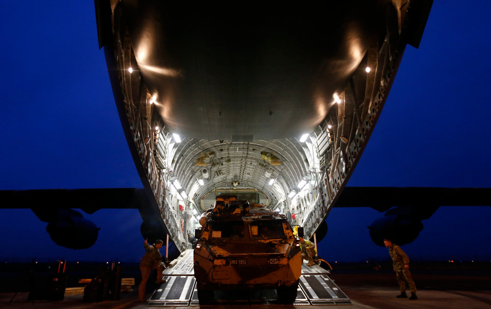 Description of . A French military armoured personnel carrier is loaded onto a Royal Air Force C-17 aircraft at Evreux in northern France, January 14, 2013. Britain is lending logistical support to France as it sends troops and military equipment to Mali.  REUTERS/Andrew Winning