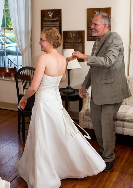 Bride pulling father out to dance.jpg