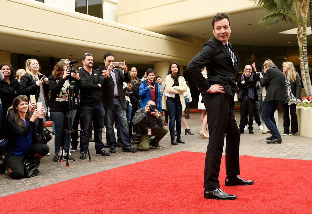 . Jimmy Fallon, host of the 74th Annual Golden Globe Awards, strikes a pose after rolling out the red carpet during Golden Globe Awards Preview Day at the Beverly Hilton on Wednesday, Jan. 4, 2017, in Beverly Hills, Calif.  The awards will be held on Jan. 8, and air on NBC. (Photo by Chris Pizzello/Invision/AP)