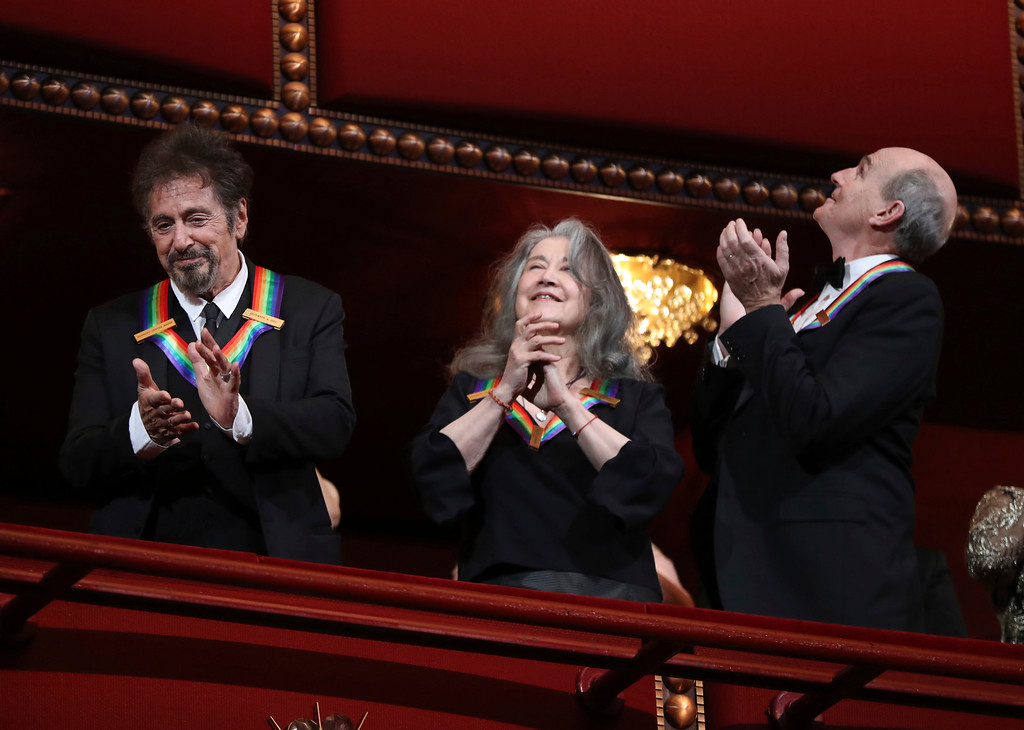 . Recipients of the 2016 Kennedy Center Honor award, actor Al Pacino, Argentine pianist Martha Argerich and musician James Taylor, applaud during the Kennedy Center Honors gala at the Kennedy Center in Washington, Sunday, Dec. 4, 2016. (AP Photo/Manuel Balce Ceneta)