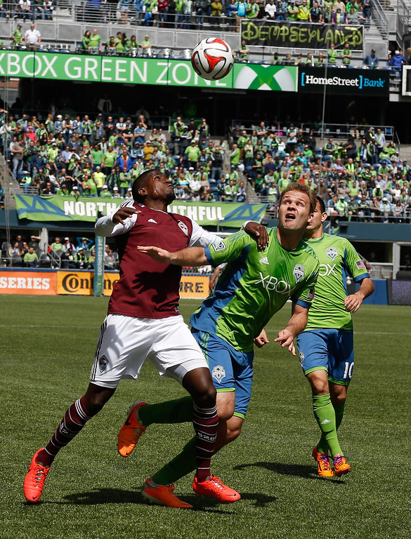 . Edson Buddle #9 of the Colorado Rapids battles Chad Marshall #14 of the Seattle Sounders FC at CenturyLink Field on April 26, 2014 in Seattle, Washington. The Sounders defeated the Rapids 4-1.  (Photo by Otto Greule Jr/Getty Images)