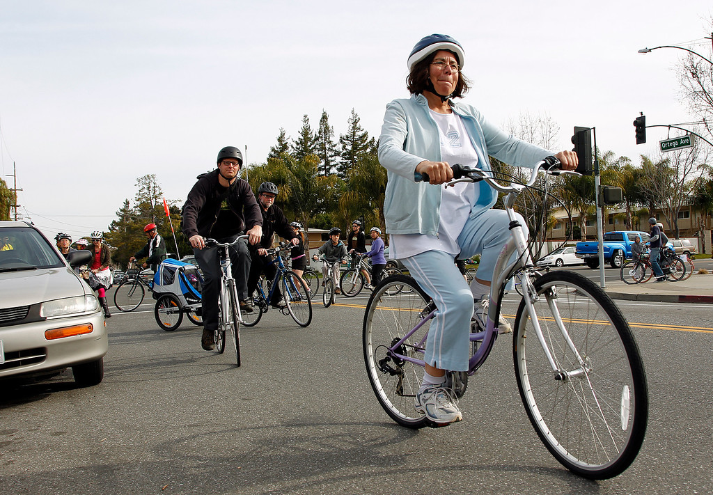. Elena Pacheco rides along Ortega Ave. during the Great Streets Rengstorff Park Neighbor Bike Tour in Mountain View, Calif. on Sat., March 2, 2013. (LiPo Ching/Staff)