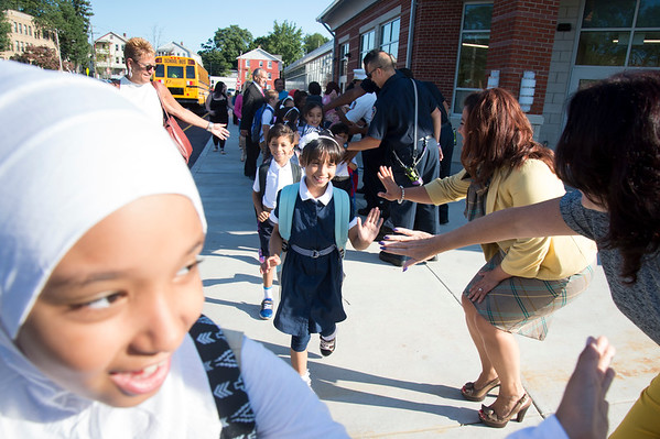 09/03/19 Wesley Bunnell | StaffrrMayor Erin Stewart shown in the background high fives students as they arrive at Smalley School for their first day of school on Tuesday September 3, 2019.