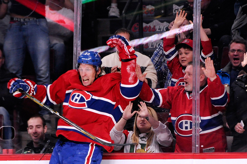 . MONTREAL, QC - MARCH 18:  Travis Moen #32 of the Montreal Canadiens celebrates after scoring his second-period goal during the NHL game against the Colorado Avalanche at the Bell Centre on March 18, 2014 in Montreal, Quebec, Canada.  (Photo by Richard Wolowicz/Getty Images)