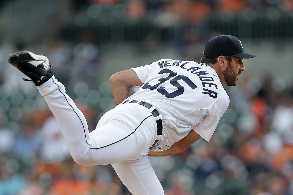 . Detroit Tigers pitcher Justin Verlander throws against the Kansas City Royals in the first inning of a baseball game in Detroit, Monday, June 16, 2014.  (AP Photo/Paul Sancya)