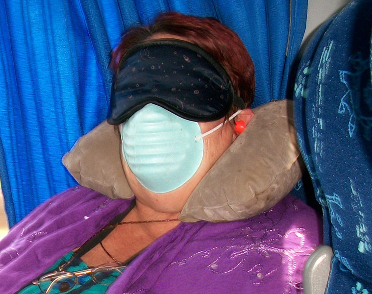 I'm allergic to air-conditioning - especially in a bus/car/cruise ship, I had only gotten 2 hours sleep (hence the mask), it was noisy (hence the ear plugs), Have my blow up pillow & a sarong keeping me warm.  Imagine getting onto the bus & seeing this scene!!!