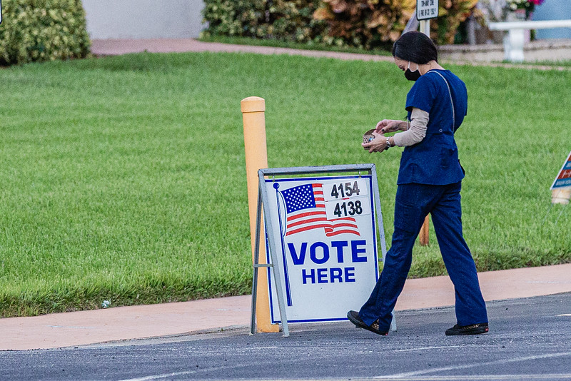 A voter walks past a Vote Here sign, into the Ascension Catholic Church in Boca Raton, on Election Day, Tuesday, November 3, 2020. (JOSEPH FORZANO / THE PALM BEACH POST)