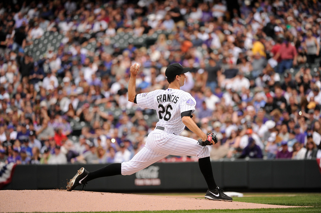 . Jeff Francis (26) of the Colorado Rockies warms up before the start of the first inning.  (Photo by Karl Gehring/The Denver Post)