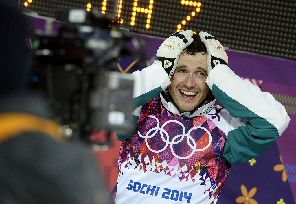 . Silver Medallist, Australia\'s David Morris celebrates in the Men\'s Freestyle Skiing Aerials finals at the Rosa Khutor Extreme Park during the Sochi Winter Olympics on February 17, 2014. FRANCK FIFE/AFP/Getty Images