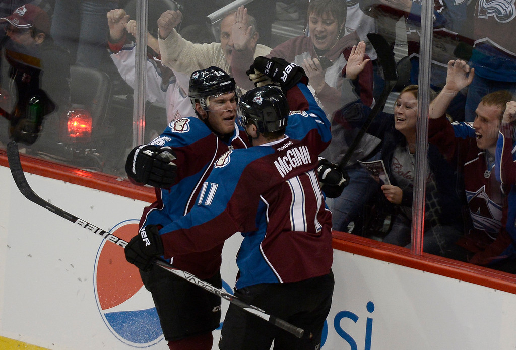. Colorado Avalanche center Paul Stastny (26) celebrates his goal with Colorado Avalanche left wing Jamie McGinn (11) during the second period against the Nashville Predators November 6, 2013 at Pepsi Center. (Photo by John Leyba/The Denver Post)