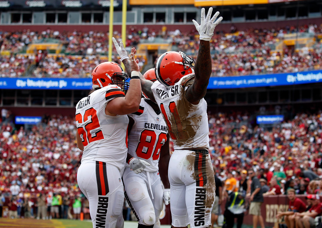 . Cleveland Browns wide receiver Terrelle Pryor (11) celebrates his touchdown during the first half of an NFL football game against the Washington Redskins, Sunday, Oct. 2, 2016, in Landover, Md. (AP Photo/Carolyn Kaster)
