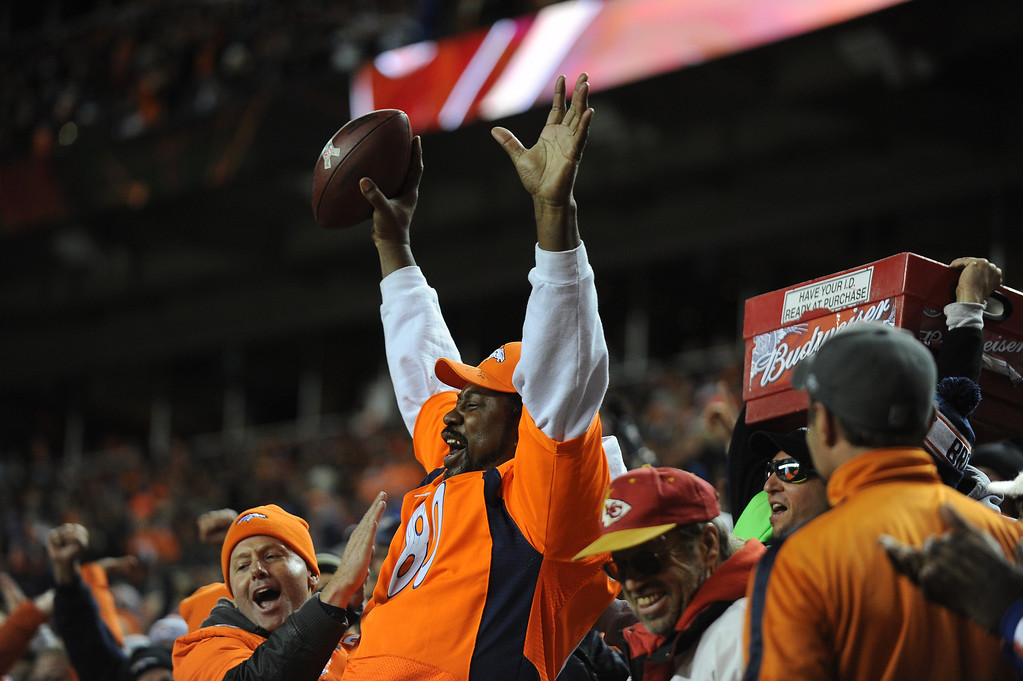 . DENVER, CO - NOVEMBER 17: Denver Broncos tight end Julius Thomas (80)\'s father, Greg Thomas, cheers after his son scored a touchdown and gave him the ball in the first quarter. The Denver Broncos take on the Kansas City Chiefs at Sports Authority Field at Mile High in Denver on November 17, 2013. (Photo by Tim Rasmussen/The Denver Post)