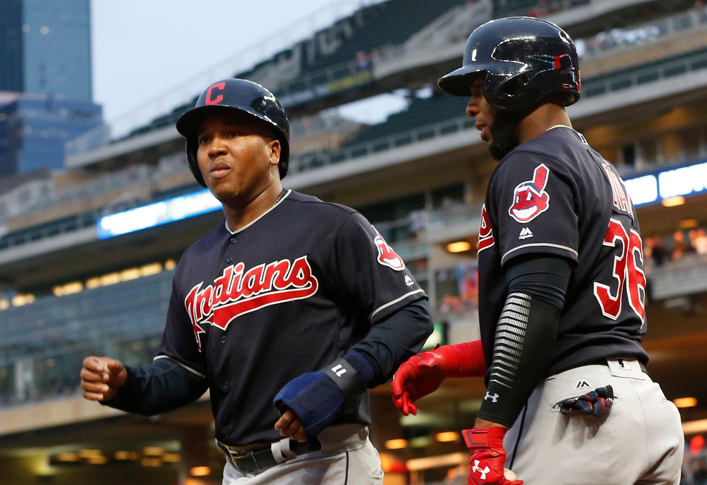 . Cleveland Indians\' Jose Ramirez, left, is congratulated by Yandy Diaz after scoring against the Minnesota Twins during the first inning of a baseball game Tuesday, April 18, 2017, in Minneapolis. Ramirez hit a two-run home in the third. (AP Photo/Jim Mone)