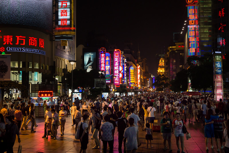 Shanghai residents enjoy a Saturday night on the Nanjing Road pedstrian mall, 20 June 2015
