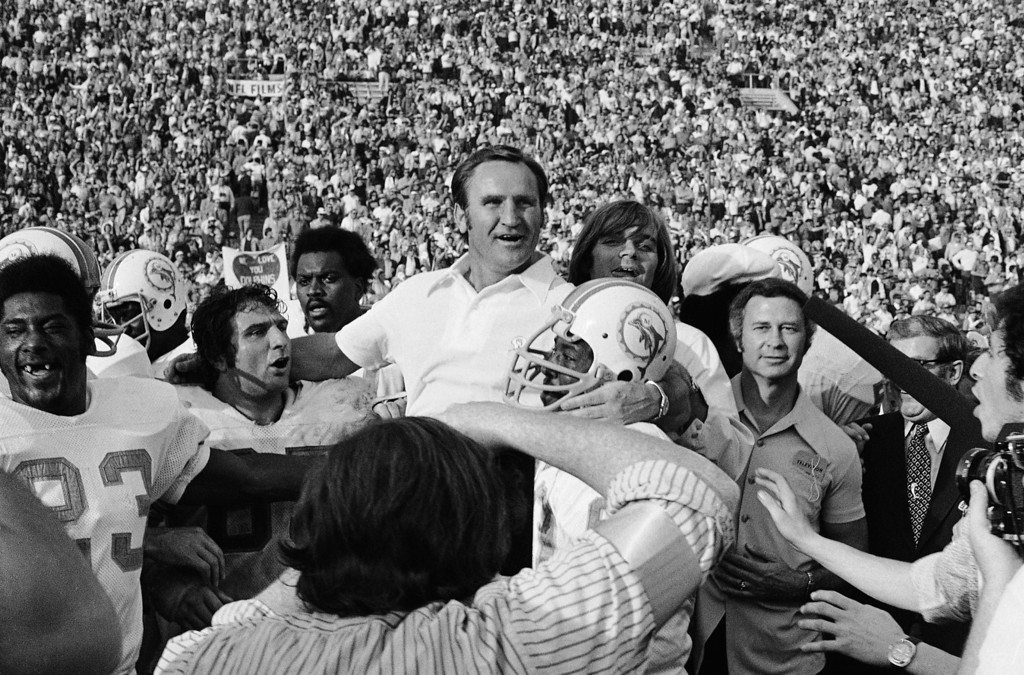 . A smiling Miami Dolphins Coach Don Shula is carried off the field after his team won the Super Bowl game with a 14-7 victory over Washington in Los Angeles on Jan. 14, 1973. Dolphins finished the season undefeated with a 17-0 record. (AP Photo)
