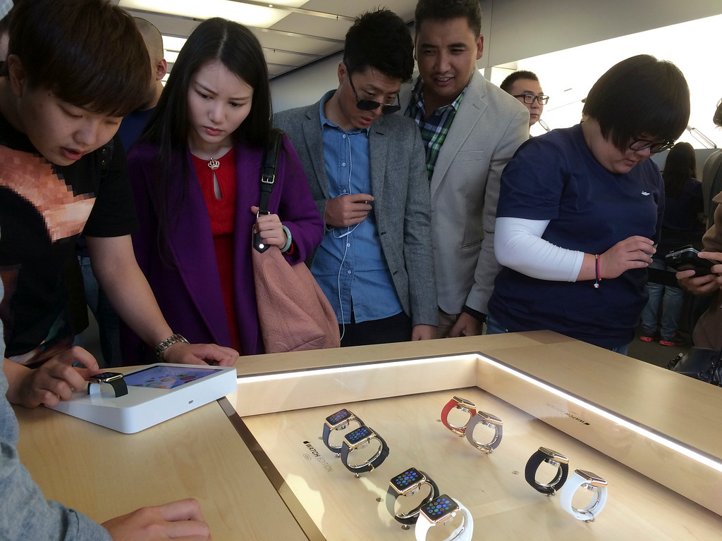 . Customers line up to try the Apple Watch at an Apple retail store in Beijing, Friday, April 10, 2015. From Beijing to Paris to San Francisco, the Apple Watch made its debut Friday. Customers were invited to try them on in stores and order them online. China was among countries where the watch had its global debut Friday, reflecting the country\'s fast-growing status as one of Apple\'s most important markets. (AP Photo/Ng Han Guan)