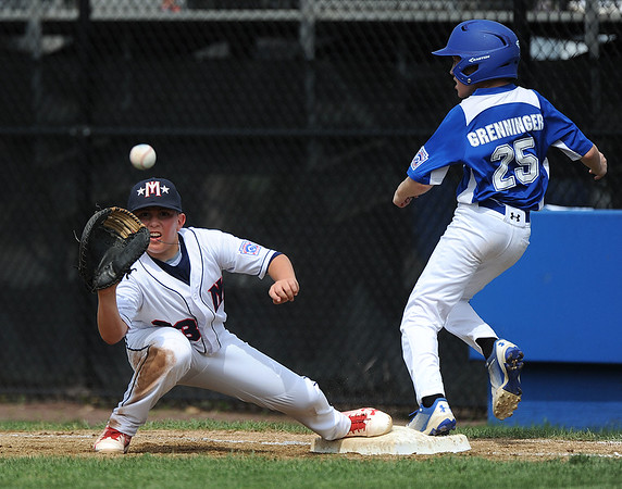 8/6/2018 Mike Orazzi   Staff' Mid Island New York's John Calabrese (23) and Kevin Grenninger (25) during the 2018 Little League Eastern Regional Tournament at Breen Field in Bristol Monday morning.