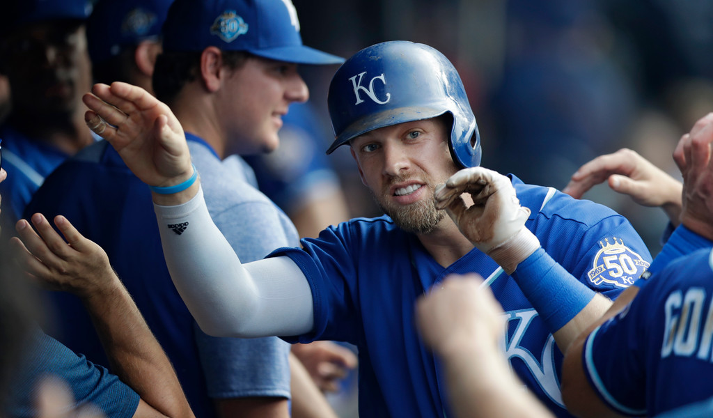. Kansas City Royals\' Hunter Dozier is congratulated by teammates after  hitting a solo home run off Cleveland Indians relief pitcher Jon Edwards in the eighth inning of a baseball game, Monday, Sept. 3, 2018, in Cleveland. (AP Photo/Tony Dejak)