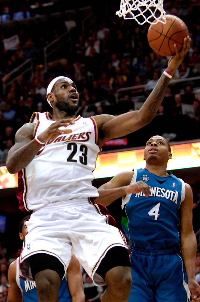 . Jeff Forman/JForman@News-Herald.com LeBron James shoots over Randy Foye of the Timberwolves during the first half of the Cavaliers\'s win Friday at Quicken Loans Arena.