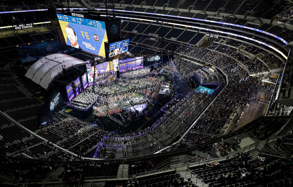 . South Carolina\'s Hayden Hurst is shown on the screen at AT&T Stadium after being selected by the Baltimore Ravens during the first round of the NFL football draft, Thursday, April 26, 2018, in Arlington, Texas. (AP Photo/David J. Phillip)