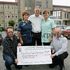 Martin McConell, David McIlory and Oliver Malone members of Bessbrook Vintage Club present Christina Monaghan and Angela Fegan Staff Nurses Southern Area Hospice with a cheque for £1015 proceeds of the Lakeside Tractor run 2006. A Vintage working and Fun day will also take place on the 16th September at Maytown Bessbrook which will be open to the public proceeds to SAH. 06W32N27