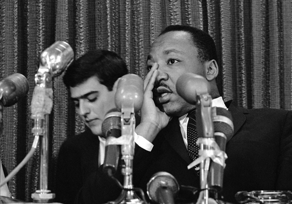 . Dr. Martin Luther King pauses before answering a question during a press conference in Denver, May 18, 1967. Dr. King is in Denver to deliver an address at the University of Denver. After his brief stop in Colorado, Dr. King, will continue on to Chicago. (AP Photo)
