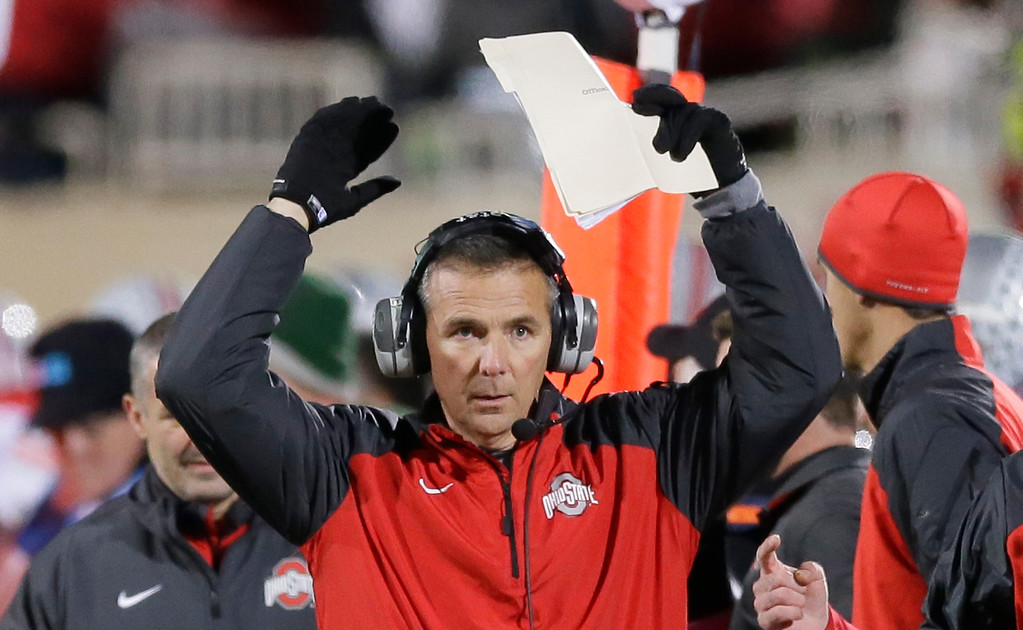 . Ohio State coach Urban Meyer reacts on the sidelines during the first half of an NCAA college football game against Michigan State in East Lansing, Mich., Saturday, Nov. 8, 2014. (AP Photo/Carlos Osorio)