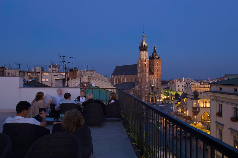 Poland, Cracow, terrace bar of Hotel Stary and view of Rynek Glowny in the evening